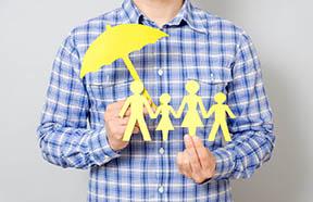 paper family under umbrella