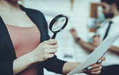 person with magnifying glass