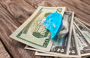 pacifier on top of money