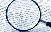 magnifying glass and document