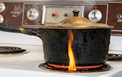 flaming burner on stove