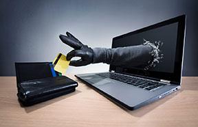 hand stealing card through computer