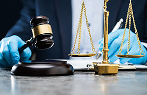 judge with gloves and a gavel