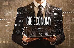 businessman holding gig economy sign