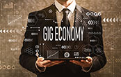 businessman holding gig economy sign