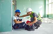 man helping injured worker